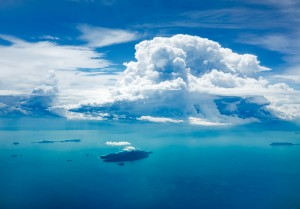 Cloud and ocean with island, aerial view